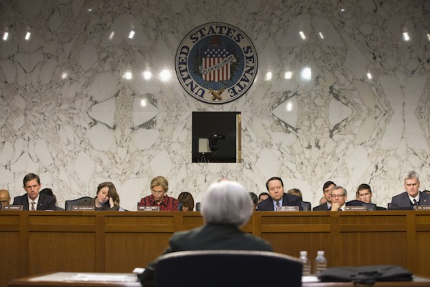 Federal Reserve Chair Janet Yellen, center, testifies on Capitol Hill in Washington, Thursday, Dec. 3, 2015, before the Joint Economic Committee. At rear, from left are, Sen. Martin Heinrich, D-N.M., Sen. Amy Klobucher, D-Minn., Rep. Carolyn Maloney, D-N.Y., Committee Vice Chairman Rep. Patrick Tiberi, R-Ohio, Rep. David Schweikert, R-Ariz., and Sen. Bill Cassidy, R-La. (AP Photo/Jacquelyn Martin)